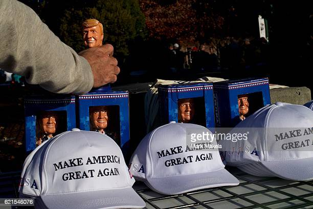 A seller arranges Donald Trump merchandise before a rally with the Republican Presidential nominee at Giant Center November 4 2016 in Hershey...
