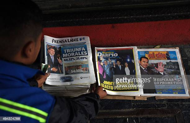 A seller arranges newspapers in Guatemala city on October 26 the day after general elections Jimmy Morales a comic actor and TV personality declared...