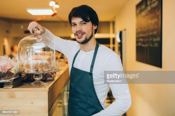 seller at a pastry shop - lid foto e immagini stock