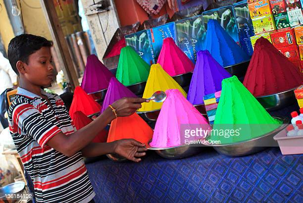 Seller at the famous and colourful Devaraja Market and bazaar offering vegetables, fruits and flowers and conicle piles of kumkum at December 18,...