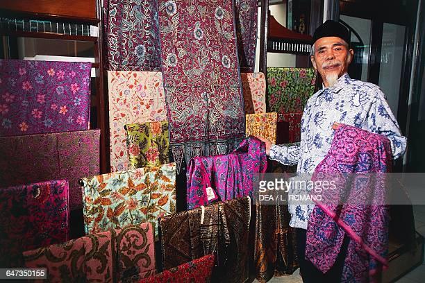 Seller of batik traditional textile Java Indonesia