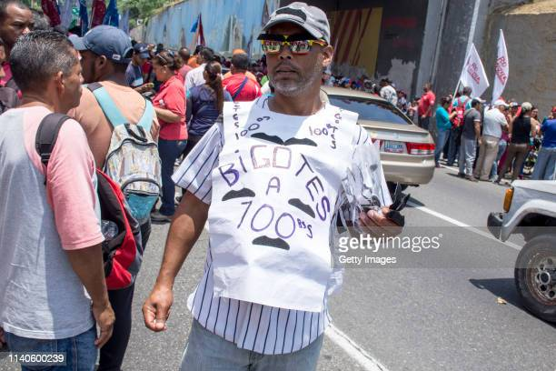 A seller of offers mustaches during a demonstration in support to Venezuelan President Nicolás Maduro on May 1 2019 in Caracas Venezuela Yesterday...
