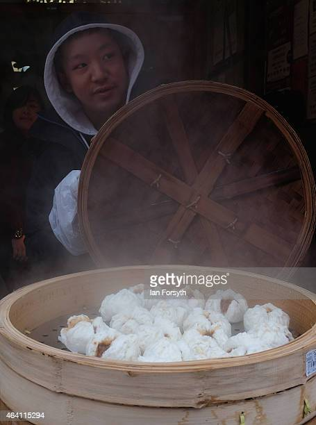 A seller of pork dough balls offers his wares to visitors as the Chinese community come together to welcome in the Chinese New Year on February 22...