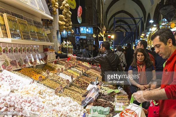 Seller of traditional sweetmeats Turkish Delight Lokum in Misir Carsisi Egyptian Bazaar food and spice market Istanbul Turkey