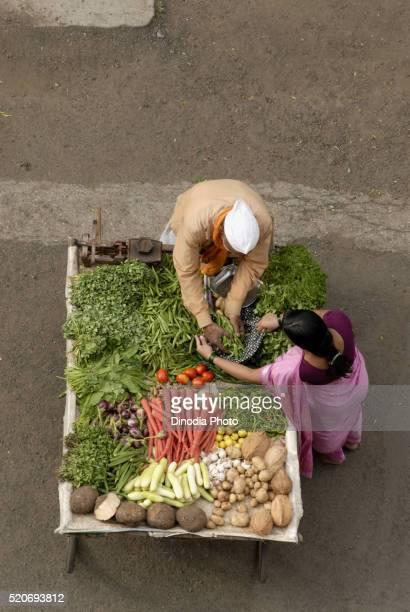 Seller Sales vegetables on Handcart Pune Maharashtra