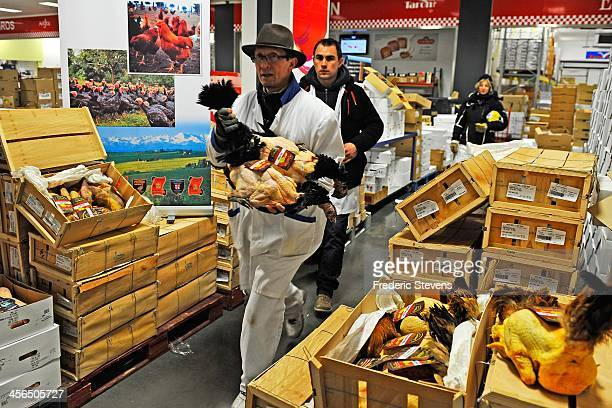 A seller selects a chicken in the poultry department of the Rungis Market on December 13 2013 in Rungis France Rungis is the world's largest...