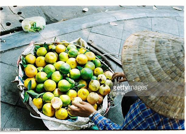 Seller selling oranges on street