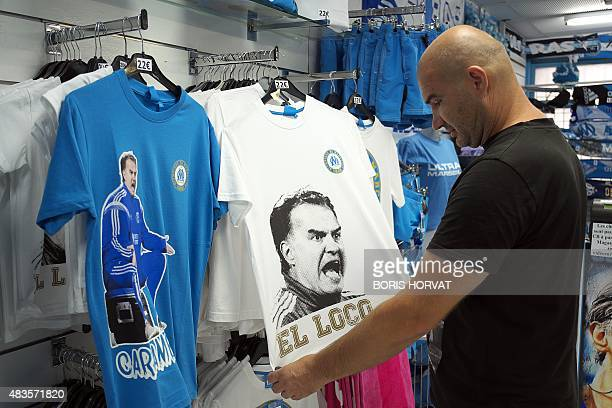 A seller stores tshirts picturing Marseille's former head coach Marcelo Bielsa in a supporters shop on August 10 2015 in Marseille AFP PHOTO / BORIS...