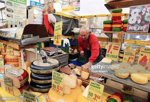 Seller traditional Dutch cheese at Albert Cuyp Market in Amsterdam, Netherlands