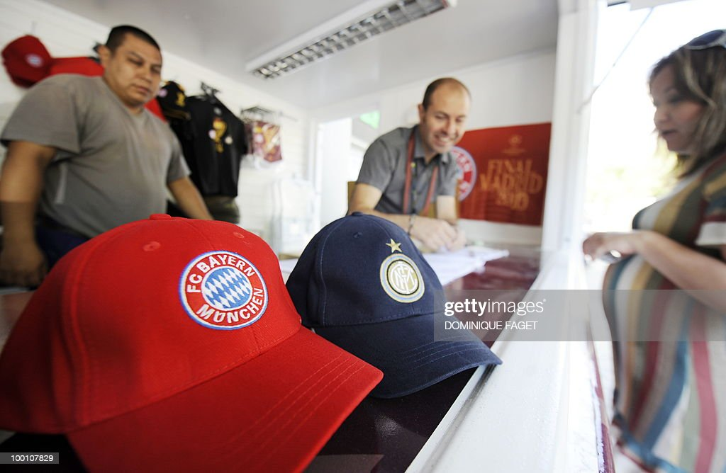 Sellers display Bayern Munich and Inter Milan caps for sale at Santiago Bernabeu stadium in Madrid on May 21, 2010 ahead of the UEFA Champions League final. Inter Milan will face Bayern Munich for the UEFA Champions League final match to be played at the Santiago Bernabeu Stadium in Madrid on May 22, 2010.