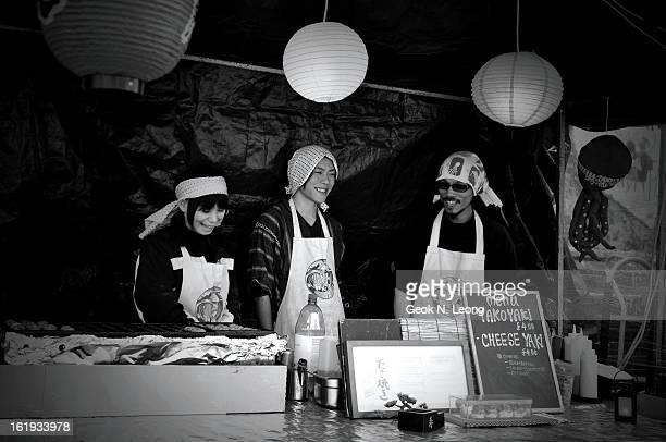 Sellers, food stall, famous weekend market selling Takoyaki, octopus balls. Camden Markets, London, UK 2011