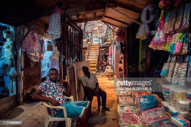 Sellers sit outside their shops in the Ariaria International Market famous for shoe making and leather work in Aba a city in one of the proBiafran...