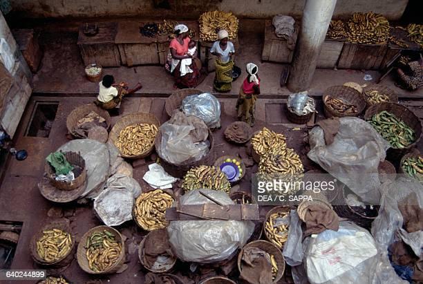 Selling bananas Kaneshie Market Accra Ghana