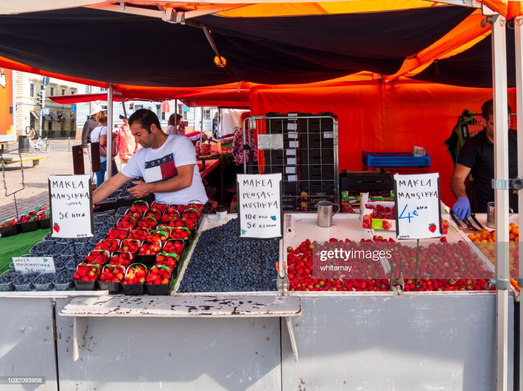 Selling berry fruits in the harbour market in Helsinki : Stock Photo