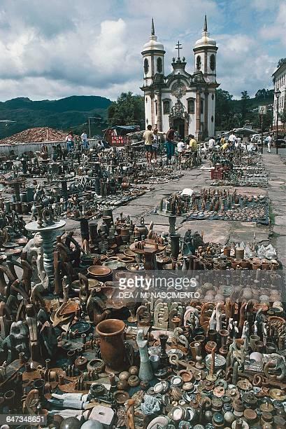 Selling ceramics Tiradentes square market Ouro Preto Minas Gerais Brazil