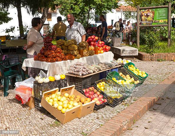 Selling chestnuts at a fruit and vegetable market stall in the village of Galaroza Sierra de Aracena Huelva province Spain
