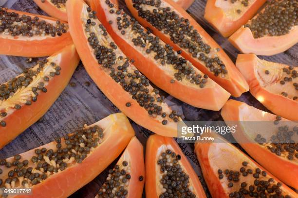 Selling fresh papaya from the train tracks at Thamaing station on 24th November 2016 in Yangon Myanmar Thamaing is one of the 39 stations on the...