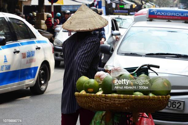 selling fruits on a bicycle in Hanoi, Vietnam