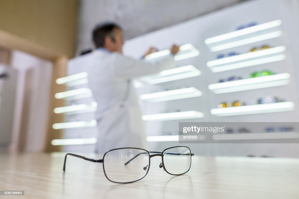 Selling glasses at an optics : Stock Photo