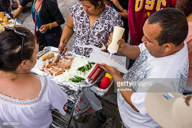 selling hot dogs during cinco de mayo celebration, la - cinco de mayo stock photos and pictures
