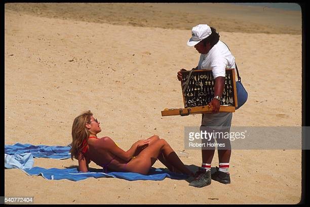 Selling Jewelry to Anxious Sunbather in Cabo San Lucas