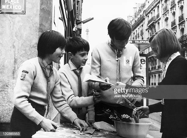 Selling lilies of the valley in Paris France Boy scouts selling bunches of lily of the valley on May 1st in Paris