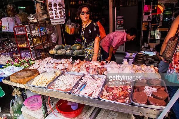 Selling raw meat at the market