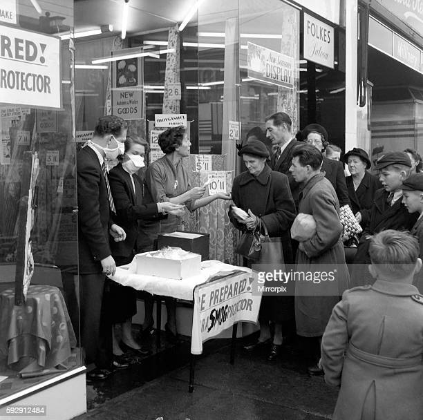 Selling Smog Mask in London. January 1953 D6497