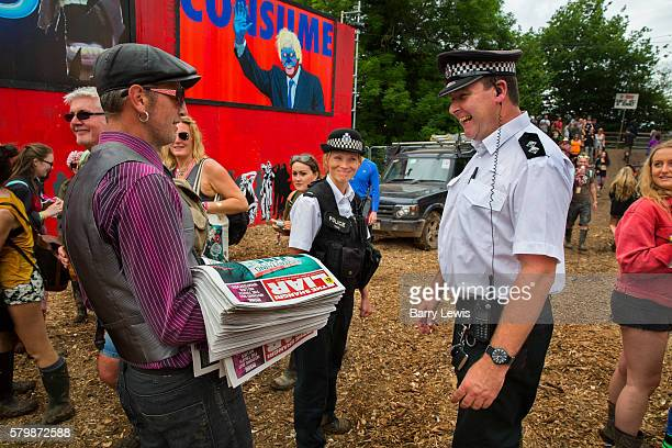 Selling the Shangri Liar an ironic tabloit style newspaper raising money for the refugee kitchens in Calais and Dunkirk to a policeman patrolling the...