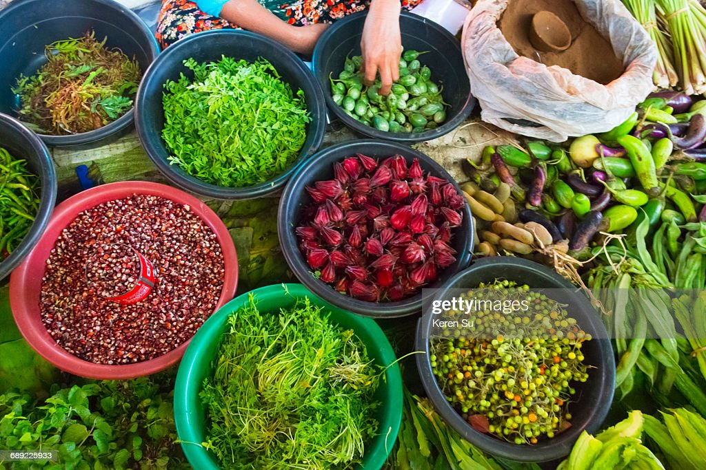 Selling vegetables at local market : Stock Photo