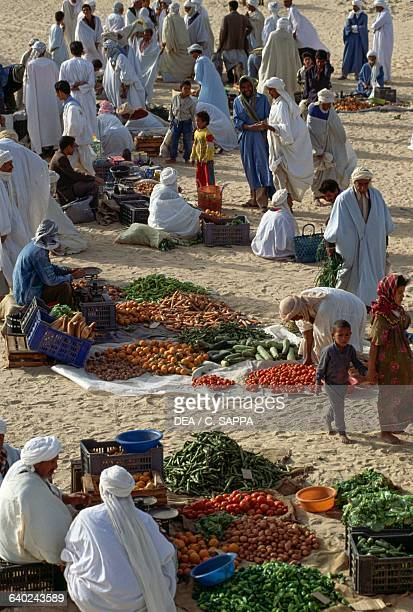 Selling vegetables at the market in El Khoubna between Touggourt and El Oued Algeria