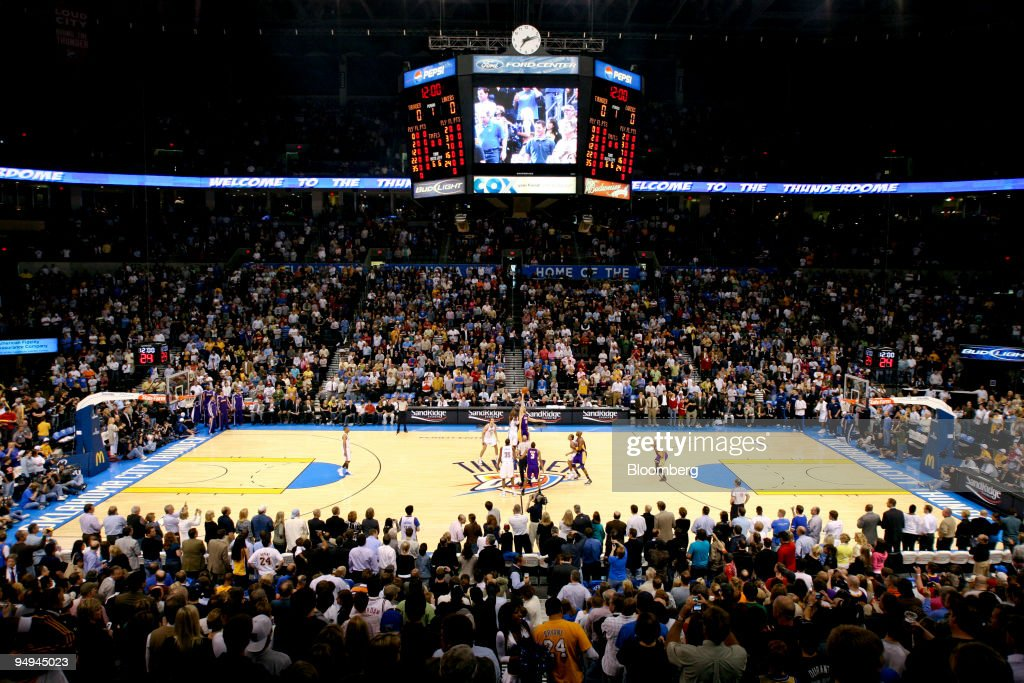 A sellout crowd of 19,136 watches the tipoff during a National Basketball Association (NBA) game between the Los Angeles Lakers and the Oklahoma City Thunder at Ford Center in Oklahoma City, Oklahoma, U.S., on Tuesday, March 24, 2009. Nearly three decades after an energy bust that forced 122 banks to close statewide, Oklahoma City is in the fifth year of an economic expansion that's produce the lowest jobless rate for a major metro U.S. area. Oklahoma City demonstrated it could support a NBA team, encouraging the Seattle Supersonics to move permanently and become the Thunder, which now draw crowds as large as the Boston Celtics.