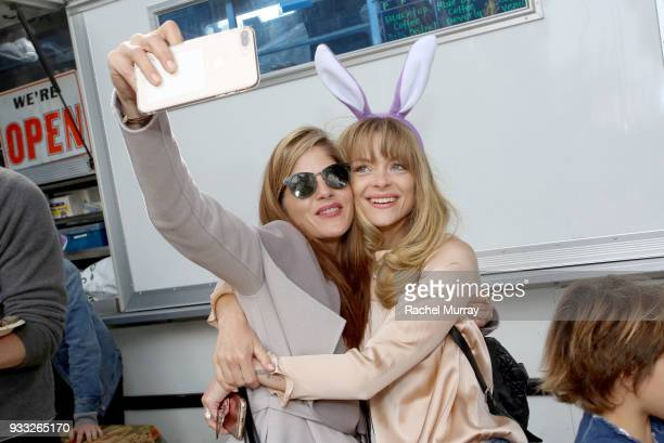 Selma Blair and Jaime King ring in 2014 with celebratory smooch