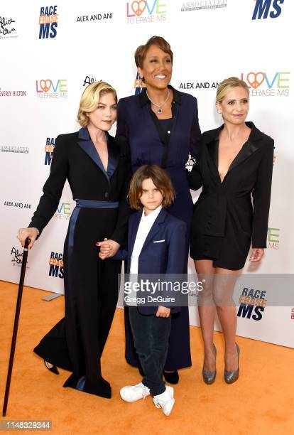 Selma Blair, Arthur Saint Bleick, Robin Roberts, and Sarah Michelle Gellar attend the 26th Annual Race to Erase MS Gala at The Beverly Hilton Hotel...