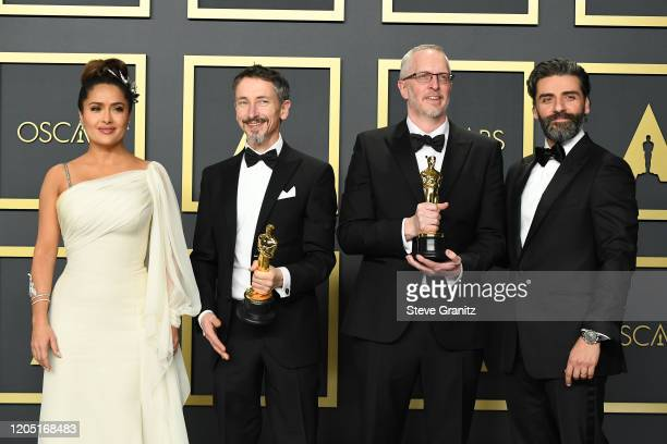 "Selma Hayek, Sound editors Mark Taylor and Stuart Wilson, winners of the Sound Mixing award for ""1917,"" and Oscar Isaac pose in the press room during..."
