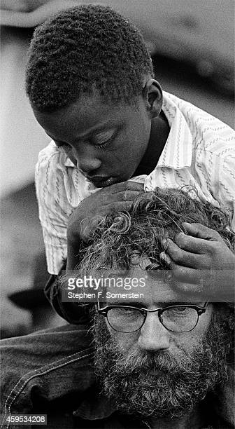 Selma To Montgomery Civil Rights March with Canadian marcher carrying injured young Negro boy on his shoulders On March 25 1965 in Montgomery Alabama