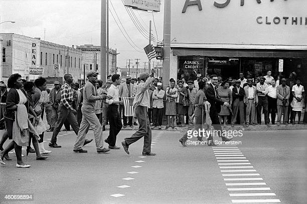 Selma to Montgomery civil rights marchers in black part of Montgomery business section with mostly black onlookers in front of Askins Clothing store...