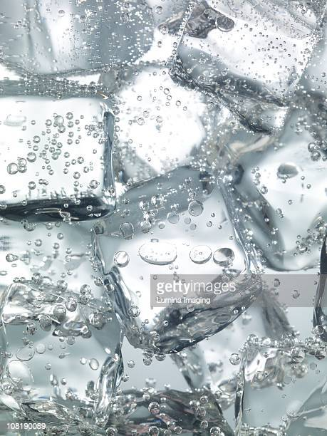 seltzer and ice - ice cube stock photos and pictures