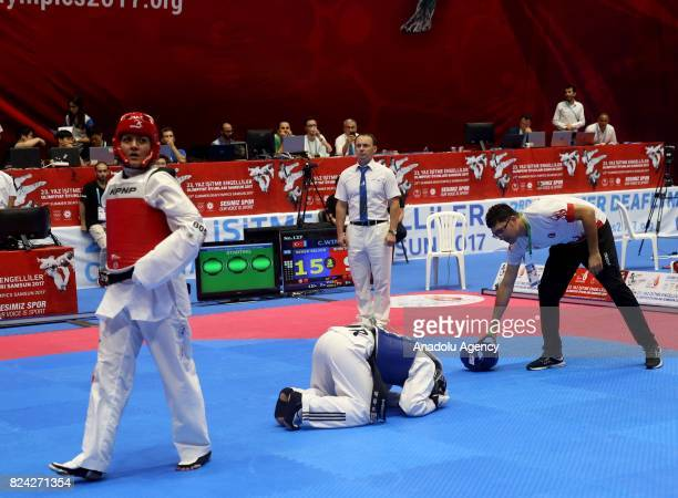 Selver Seker of Turkey celebrates gold medal after fighting against Mouna Shiri Tazehgheshlagh of Iran in Women's Taekwondo 67kg final match within...