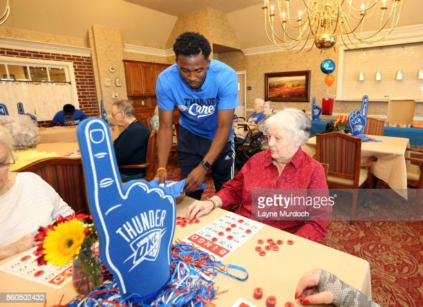 Semaj Christon and Daniel Hamilton of the Oklahoma City Thunder play bingo with local senior citizens on September 21 2017 at the Brookdale Village...