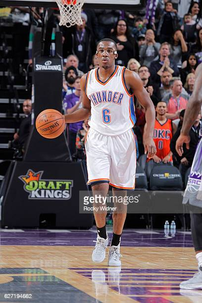 Semaj Christon of the Oklahoma City Thunder brings the ball up the court against the Sacramento Kings on November 23 2016 at Golden 1 Center in...