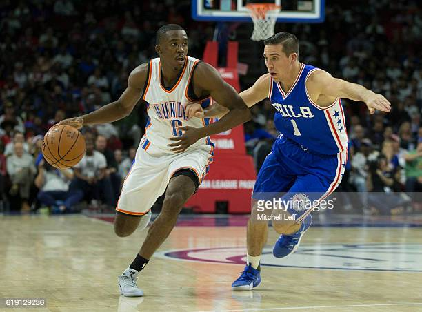 Semaj Christon of the Oklahoma City Thunder dribbles the ball against TJ McConnell of the Philadelphia 76ers at Wells Fargo Center on October 26 2016...