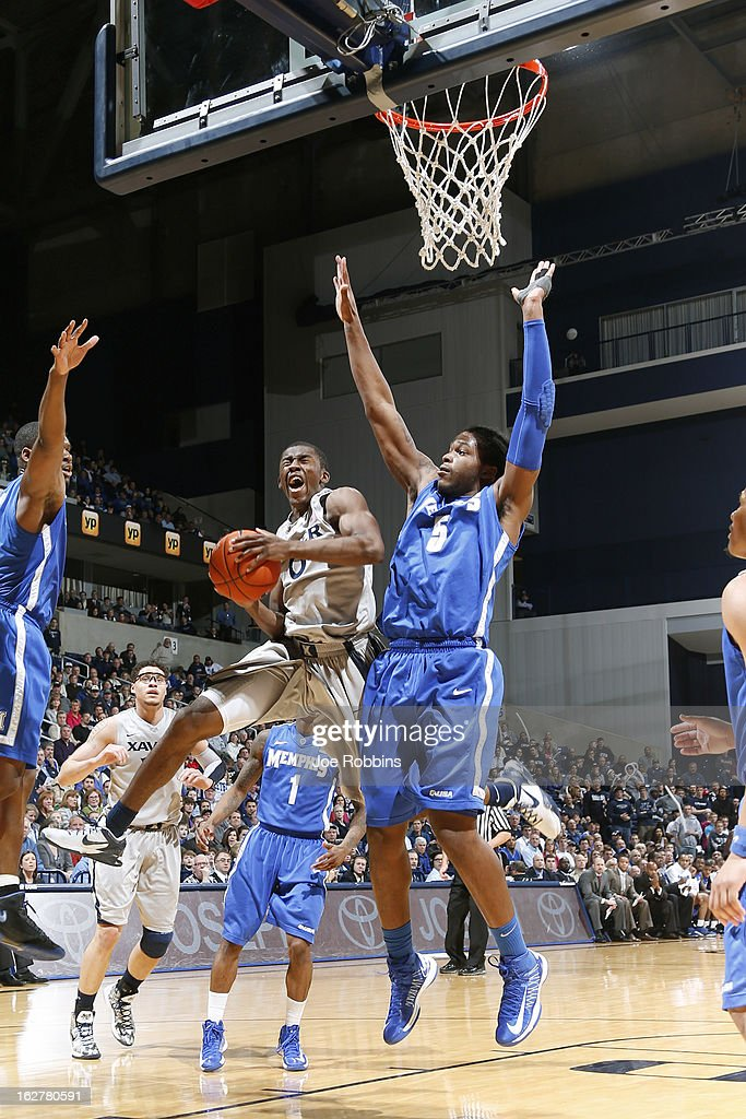 Semaj Christon #0 of the Xavier Musketeers drives to the basket against Shaq Goodwin #5 of the Memphis Tigers during the game at Cintas Center on February 26, 2013 in Cincinnati, Ohio. Xavier defeated Memphis 64-62.