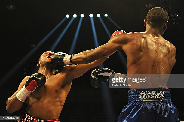 Semajay Thomas exchanges punches with Kevin Womack in their welterweight match at the DC Armory on January 25, 2014 in Washington, DC. Their match...