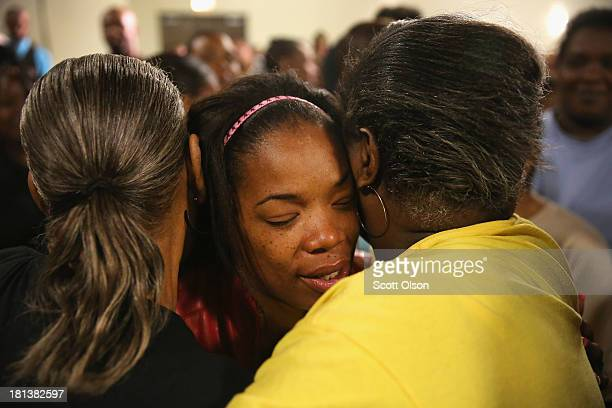 Semehca Nunn is comforted following a prayer service at New Beginnings Church for the victims of yesterday's mass shooting on September 20 2013 in...