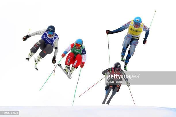 Semen Denshchikov of Russia leads Jamie Pebble of New Zealand Marc Bischofberger of Switzerland and Francios Place of France during the Men's Ski...