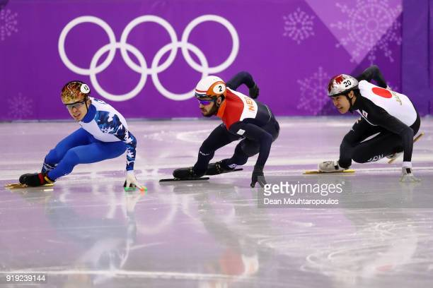 Semen Elistratov of Olympic Athlete from Russia Sjinkie Knegt of the Netherlands Ryosuke Sakazume of Japan compete during the Short Track Speed...