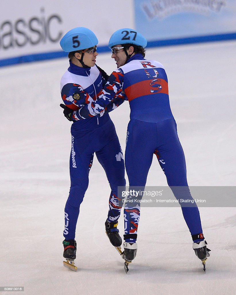 Semen Elistratov of Russia (L) celebrates with team mate Dmitry Migunov after the Men 5000 M Relay Final during day two of the ISU World Cup Short Track Speed Skating at EnergieVerbund Arena on February 7, 2016 in Dresden, Germany.