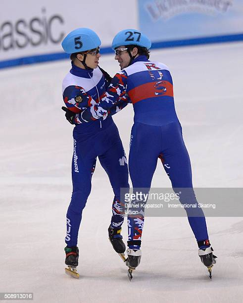 Semen Elistratov of Russia celebrates with team mate Dmitry Migunov after the Men 5000 M Relay Final during day two of the ISU World Cup Short Track...
