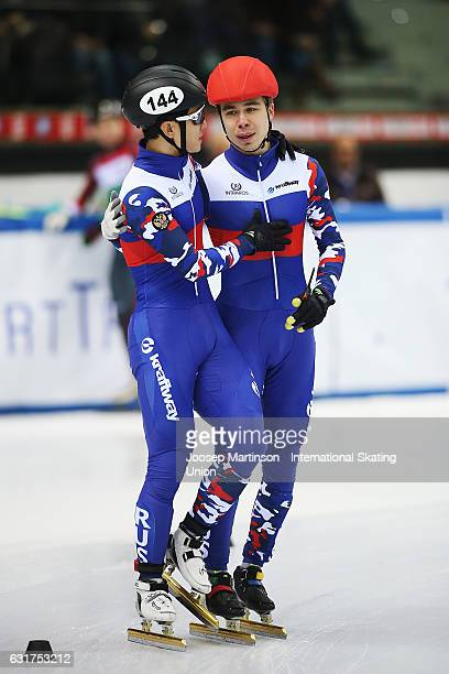 Semen Elistratov of Russia is congratulated by teammate Victor An in the 3000m Super Final during day 2 of the European Short Track Speed Skating...